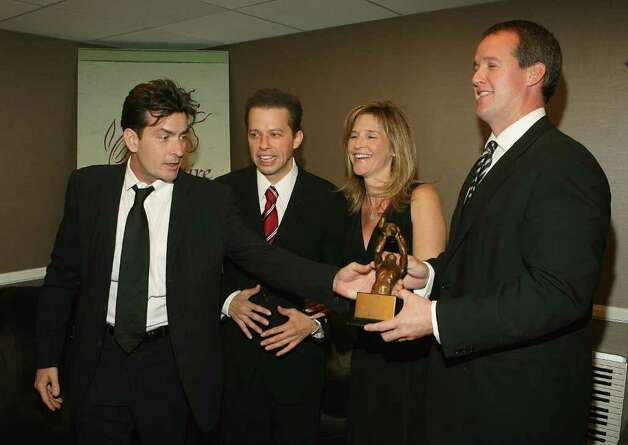 BEVERLY HILLS, CA - OCTOBER 14:  (L-R) Actor Charlie Sheen, actor Jon Cryer, producer Kim Tannenbaum and producer Eric Tannenbaum pose backstage at the 9th Annual Dinner Benefitting the Lili Claire Foundation at the Beverly Hilton Hotel on October 14, 2006 in Beverly Hills, California. Photo: Michael Buckner, Getty Images / 2006 Getty Images