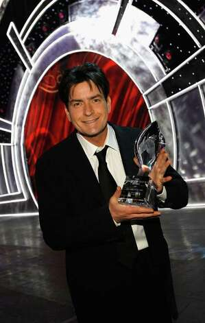 LOS ANGELES, CA - JANUARY 09:  Actor Charlie Sheen poses with his award for Favorite TV Comedy in the audience during the 33rd Annual People's Choice Awards held at the Shrine Auditorium on January 9, 2007 in Los Angeles, California. Photo: Vince Bucci / 2007 Getty Images