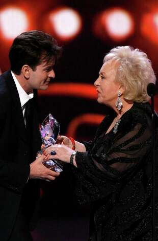 "LOS ANGELES, CA - JANUARY 09:  Actor Charlie Sheen accepts the award for ""Favorite TV Comedy"" from actress Doris Roberts onstage during the 33rd Annual People's Choice Awards held at the Shrine Auditorium on January 9, 2007 in Los Angeles, California. Photo: Kevin Winter, Getty Images / 2007 Getty Images"