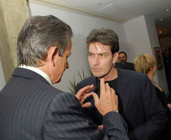 LOS ANGELES, CA - FEBRUARY 15:  President of Omega Stephen Urquhart (L) and actor Charlie Sheen attend a cocktail reception for Omegamania-Antiquorum's preview of 300 collector's Omega timepieces soon to be auctioned at the Beverly Wilshire Hotel on February 15, 2007 in Los Angeles, California.  (Photo by Charley Gallay/Getty Images) *** Local Caption *** Stephen Urquhart; Charlie Sheen Photo: Charley Gallay, Getty Images / 2007 Getty Images
