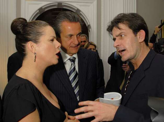 LOS ANGELES, CA - FEBRUARY 15:  (L-R) Actress Marcia Gay Harden, President of Omega Stephen Urquhart, and actor Charlie Sheen attend a cocktail reception for Omegamania-Antiquorum's preview of 300 collector's Omega timepieces soon to be auctioned at the Beverly Wilshire Hotel on February 15, 2007 in Los Angeles, California.  (Photo by Charley Gallay/Getty Images) *** Local Caption *** Marcia Gay Harden; Stephen Urquhart; Charlie Sheen Photo: Charley Gallay, Getty Images / 2007 Getty Images