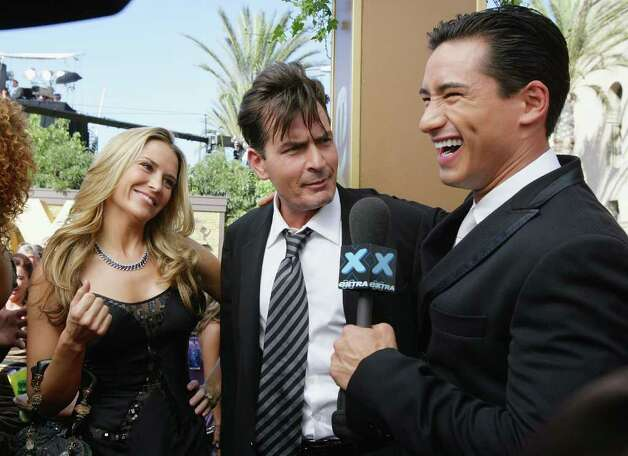 LOS ANGELES - SEPTEMBER 16:  Actor Charlie Sheen (C) and fiancee Brooke Mueller attend an interview with Extra's Mario Lopez during the 59th Annual Primetime Emmy Awards at the Shrine Auditorium September 16, 2007 in Los Angeles, California.  (Photo by Mark Mainz/Getty Images for EXTRA) *** Local Caption *** Brooke Mueller;Charlie Sheen;Mario Lopez Photo: Mark Mainz, Getty Images / 2007 Getty Images