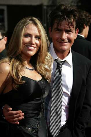 LOS ANGELES, CA - SEPTEMBER 16:  Actor Charlie Sheen and Brooke Mueller arrive at the 59th Annual Primetime Emmy Awards at the Shrine Auditorium on September 16, 2007 in Los Angeles, California.  (Photo by Frazer Harrison/Getty Images) *** Local Caption *** Brooke Mueller;Charlie Sheen Photo: Frazer Harrison, Getty Images / 2007 Getty Images