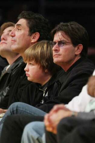 LOS ANGELES, CA - OCTOBER 30:  Actors Charlie Sheen (R) and Angus T Jones (center) attend the LA Lakers Home Opener at the Staples Center on October 30, 2007 in Los Angeles, California.  (Photo by Noel Vasquez/Getty Images) *** Local Caption *** Charlie Sheen; Angus T. Jones Photo: Noel Vasquez, Getty Images / 2007 Getty Images