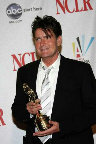 PASADENA, CA - AUGUST 17:  Actor Charlie Sheen poses with her Best Male Performance in a Comedy Series award during the 2008 ALMA Awards at the Pasadena Civic Auditorium on August 17, 2008 in Pasadena, California. Photo: Frazer Harrison, Getty Images / 2008 Getty Images