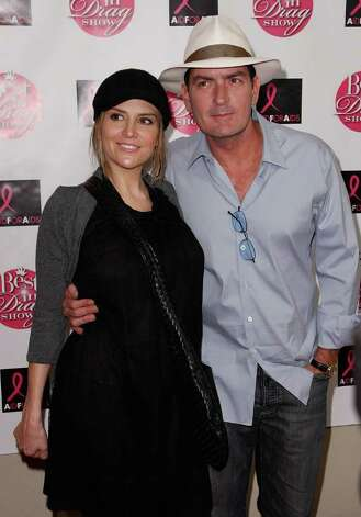 LOS ANGELES, CA - OCTOBER 19:  Actress Brooke Mueller (L) and actor Charlie Sheen arrive at the Best in Drag Aid for Aids Benefit at the Orpheum Theater on October 19, 2008 in Los Angeles, California. Photo: Michael Buckner, Getty Images / 2008 Getty Images