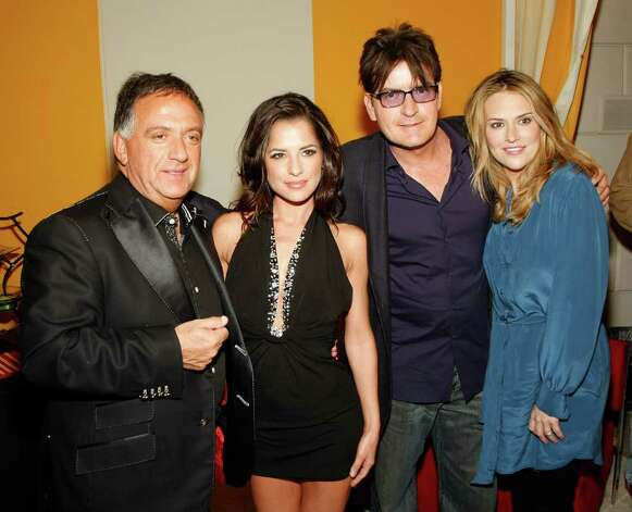 "LAS VEGAS - APRIL 18:  (L-R_ Planet Hollywood founder Robert Earl, actress Kelly Monaco, actor Charlie Sheen and his wife Brooke Sheen appear at the after party for the world premiere of the adult production ""PEEPSHOW"" at the Planet Hollywood Resort & Casino April 18, 2009 in Las Vegas, Nevada.  (Photo by Ethan Miller/Getty Images for BASE Entertainment) *** Local Caption *** Robert Earl;Kelly Monaco;Charlie Sheen;Brooke Sheen Photo: Ethan Miller, Getty Images For BASE Entertainm / 2009 Getty Images"