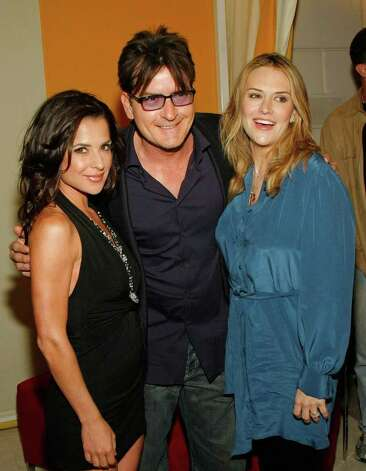 "LAS VEGAS - APRIL 18:  (L-R) Actress Kelly Monaco, actor Charlie Sheen and his wife Brooke Sheen appear at the after party for the world premiere of the adult production ""PEEPSHOW"" at the Planet Hollywood Resort & Casino April 18, 2009 in Las Vegas, Nevada.  (Photo by Ethan Miller/Getty Images for BASE Entertainment) *** Local Caption *** Kelly Monaco;Charlie Sheen;Brooke Sheen Photo: Ethan Miller, Getty Images For BASE Entertainm / 2009 Getty Images"