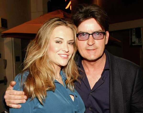 "LAS VEGAS - APRIL 18:  Actor Charlie Sheen (R) and his wife Brooke Sheen appear at the after party for the world premiere of the adult production ""PEEPSHOW"" at the Planet Hollywood Resort & Casino April 18, 2009 in Las Vegas, Nevada.  (Photo by Ethan Miller/Getty Images for BASE Entertainment) *** Local Caption *** Brooke Sheen;Charlie Sheen Photo: Ethan Miller, Getty Images For BASE Entertainm / 2009 Getty Images"