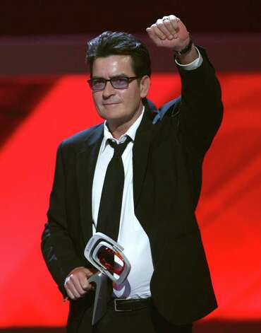"UNIVERSAL CITY, CA - APRIL 19:  Actor Charlie Sheen accepts the Future Classic Award for ""Two and a Half Men"" onstageonstage at the 7th Annual TV Land Awards held at Gibson Amphitheatre on April 19, 2009 in Unversal City, California.  (Photo by Alberto E. Rodriguez/Getty Images) *** Local Caption *** Charlie Sheen Photo: Alberto E. Rodriguez, Getty Images / 2009 Getty Images"