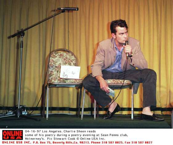 04-16-97 los Angeles, Charlie Sheen reading some of his own poetry at a poetry evening in Sean Penns club, McInerney's Photo: Stewart Cook, Getty Images / Getty Images North America