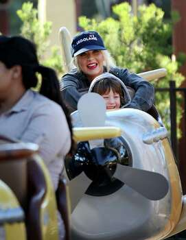 In this photo provided by Legoland, Christina Aguilera and her son Max, 3, enjoy a ride at Legoland in Carlsbad, Calif. on Monday, Feb. 14, 2010. (AP Photo/Legoland, Sandy Huffaker) NO SALES Photo: AP