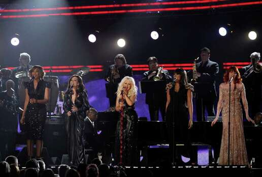 From left, Yolanda Adams, Martina McBride, Christina Aguilera, Jennifer Hudson, and Florence Welch perform  at the 53rd annual Grammy Awards on Sunday, Feb. 13, 2011, in Los Angeles. Photo: AP