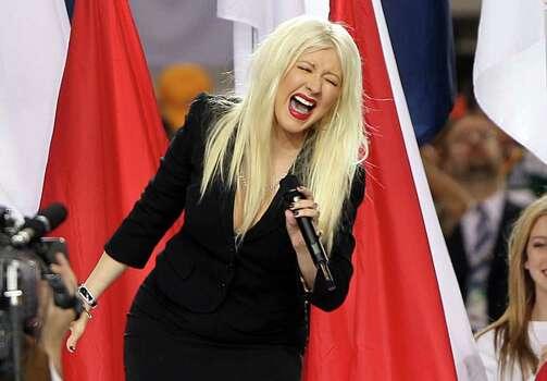ARLINGTON, TX - FEBRUARY 06:  Singer Christina Aguilera performs during the Bridgestone Super Bowl XLV Pregame Show at Dallas Cowboys Stadium on February 6, 2011 in Arlington, Texas.  (Photo by Christopher Polk/Getty Images) *** Local Caption *** Christina Aguilera Photo: Christopher Polk, Getty Images / 2011 Getty Images