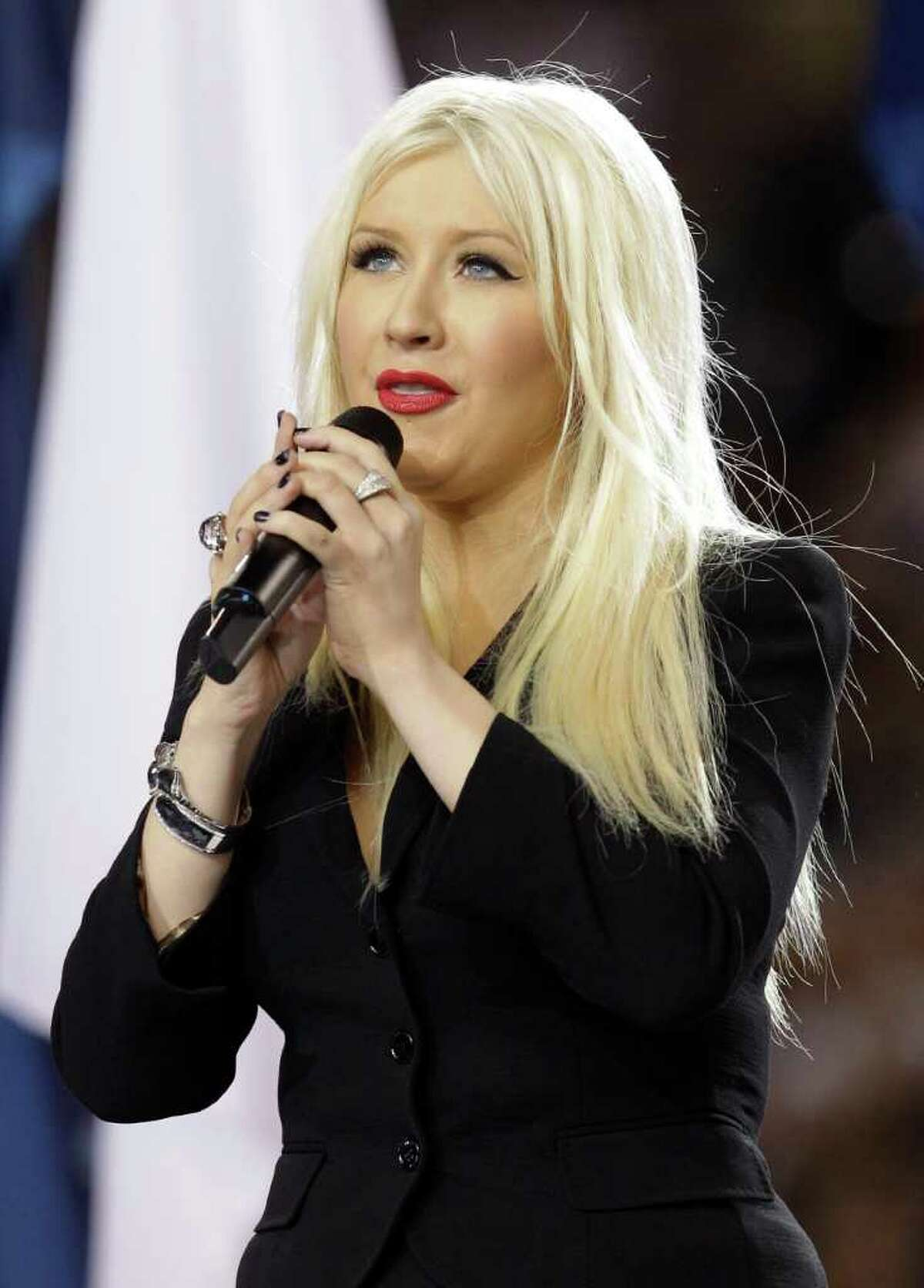 Christina Aguilera sings the national anthem before the NFL football Super Bowl XLV game between the Green Bay Packers and the Pittsburgh Steelers on Sunday, Feb. 6, 2011, in Arlington, Texas.