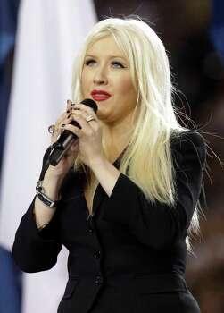 Christina Aguilera sings the national anthem before the NFL football Super Bowl XLV game between the Green Bay Packers and the Pittsburgh Steelers on Sunday, Feb. 6, 2011, in Arlington, Texas. Photo: AP