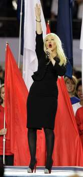 Christina Aguilera sings the national anthem before the NFL football Super Bowl XLV game between the Green Bay Packers and the Pittsburgh Steelers Sunday, Feb. 6, 2011, in Arlington, Texas. Photo: AP