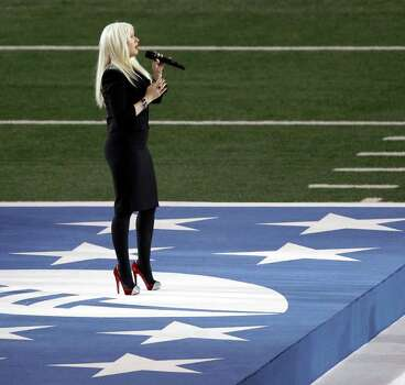 Pop star Christina Aguilera sings the national anthem before the NFL Super Bowl XLV football game between the Green Bay Packers and the Pittsburgh Steelers Sunday, Feb. 6, 2011, in Arlington, Texas. Photo: AP