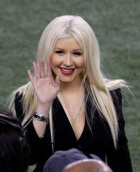 Singer Christina Aguilera stands on the field before the start of the NFL Super Bowl XLV football game between the Green Bay Packers and Pittsburgh Steelers Sunday, Feb. 6, 2011, in Arlington, Texas. Photo: AP