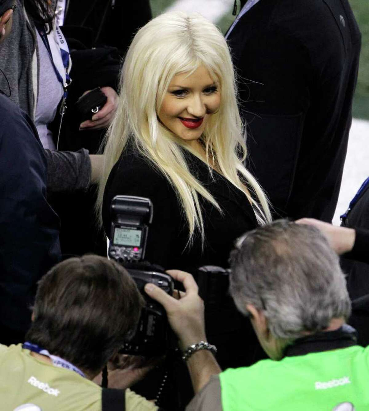 Singer Christina Aguilera poses for photographers before the start of the NFL Super Bowl XLV football game Sunday, Feb. 6, 2011, in Arlington, Texas.