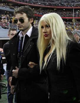 Christina Aguilera and boyfirend Matthew Rutler arrive for the NFL Super Bowl XLV football game between the Green Bay Packers and the Pittsburgh Steelers Sunday, Feb. 6, 2011, in Arlington, Texas. Aguilera will sing the national anthem before the game. Photo: AP