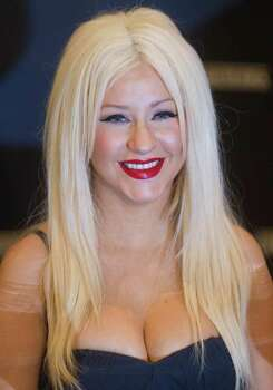 Singer Christina Aguilera holds a news conference during the Sao Paulo Fashion Week in Sao Paulo, Brazil, Tuesday Feb. 1, 2011. Aguilera is set to promote a new clothing bearing her name. Photo: AP