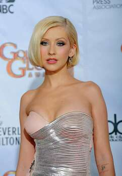 Christina Aguilera is photographed backstage at the 67th Annual Golden Globe Awards on Sunday, Jan. 17, 2010, in Beverly Hills, Calif. Photo: AP