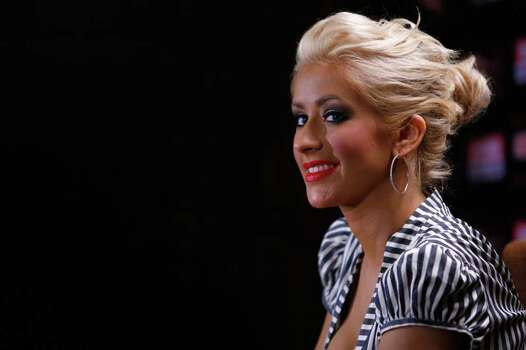 SHANGHAI, CHINA - JUNE 25: (CHINA OUT) U.S. pop star Christina Aguilera attends a news conference about her Shanghai concert June 25, 2007 in Shanghai, China. Christina will debut tomorrow on the Chinese mainland as part of her Back to Basics 2007 world tour at the Shanghai Grand Stage. (Photo by China Photos/Getty Images)  *** Local Caption *** Christina Aguilera Photo: China Photos, Getty Images / 2007 China Photos