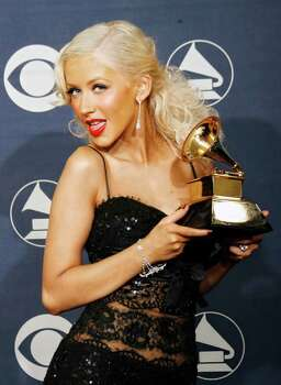 """Christina Aguilera poses with the award for best female pop vocal performance for """"Ain't No Other Man"""" at the 49th Annual Grammy Awards on Sunday, Feb. 11, 2007, in Los Angeles. Photo: Kevork Djansezian, AP / AP"""