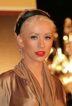 ** FILE** U.S. singer Christina Aguilera attends a press conference in London in this Wednesday Nov. 15, 2006 file photo.  Aguilera has no problem showing skin, especially on weekends with her husband, music executive Jordan Bratman. Photo: WILL LEACH, AP / AP