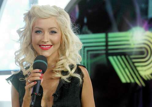"""** FILE **Christina Aguilera appears on MTV's """"Total Request Live,"""" in this June 21, 2006, file photo, at MTV studios in New York's Times Square. Aguilera has a new album titled """"Back to Basics"""" on RCA Records. Photo: STEPHEN CHERNIN, AP / AP"""