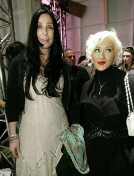 Cher (L) and Christina Aguilera pose backstage at the Agent Provocateur fashion show of the fall 2006 collection at Smashbox Studios in Culver City, California, March 20, 2006. The Los Angeles fashion week for the fall of 2006 lasts for five days and ends on Thursday.  REUTERS/Mario Anzuoni Photo: MARIO ANZUONI, REUTERS / X90045