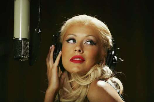 UNSPECIFIED : U.S. pop diva Christina Aguilera strikes a pose during the shooting of the latest global Pepsi commercial. The campaign called downloaded features Aguilera in a number of exotic locations, and allows fans to download a personal performance of their choice. Photo: Clive Brunskill, Getty Images / 2006 Getty Images