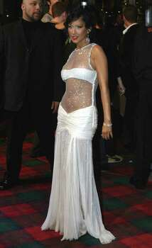 ** FILE ** Singer Christina Aguilera arrives for the MTV Europe music awards in Edinburgh, Scotland, in this Nov. 6, 2003 file photo. Aguilera sings about the abuse she says she and her mother suffered at the hand of her father in the song ``I'm Okay'' -but Aguilera did more than just sing about domestic abuse on Sunday, Dec. 21, 2003. The 23-year-old pop singer, who hails from the Pittsburgh suburb of Wexford, visited the Women's Center and Shelter of Greater Pittsburgh where she has donated $200,000. Photo: SANG TAN, AP / AP