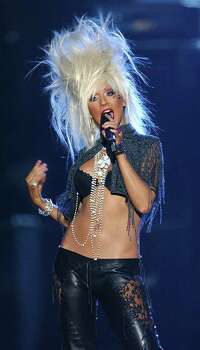 Host Christina Aguilera on stage during the MTV Europe Music Awards 2003 in, Edinburgh, Scotland Thursday Nov. 6, 2003.  ( AP Photo/PA, Anthony Harvey ) ** UNITED KINGDOM OUT  NO SALES  MAGAZINES OUT ** Photo: ANTHONY HARVEY, AP / PA