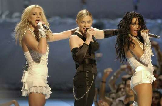 Britney Spears, left, Madonna, center, and Christina Aguilera perform during the MTV Video Music Awards at New York's Radio City Music Hall Thursday, Aug. 28, 2003. Photo: JULIE JACOBSON, AP / AP