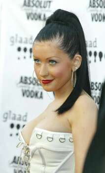 """Singer Christina Aguilera arrives at the 14th annual Gay and Lesbian Alliance Against Defamation Media Awards at the Kodak Theatre in Los Angeles on Saturday, April 26, 2003. Aguilera later received an award for including gay and transgender images in her video for the song """"Beautiful."""" Photo: JILL CONNELLY, AP / AP"""