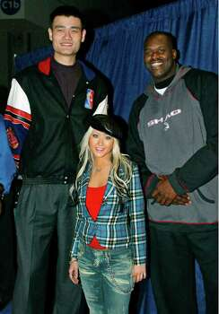 Houston Rockets' Yao Ming, of China, left, entertainer Christina Aguilera, center, and the Los Angeles Lakers' Shaquille O'Neal took part in the NBA All-Star Read to Achieve Celebration, at the World Congress Center in Atlanta, Saturday, Feb. 8, 2003, during NBA All Star activities. The event was a celebration of reading and a highlight of the NBA's Read to Achieve program, part of the league's community relations efforts. Photo: RAY AMATI, AP / NBAE