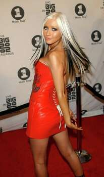 Christina Aguilera arrives at the VH-1 Awards at the Olympic Auditorium,  Los Angeles, Wednesday Dec. 4, 2002.  (AP Photo/PA, Anthony Harvey) **UNITED KINGDOM OUT NO SALES MAGAZINES OUT ** Photo: ANTHONY HARVEY, AP / PA