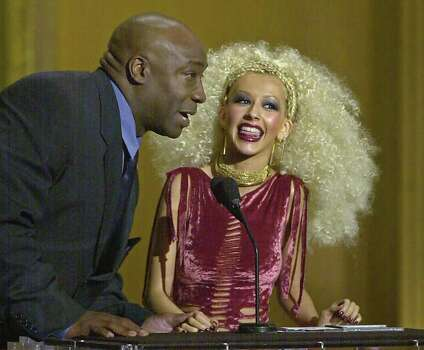 Pop singer Christina Aguilera accepts her award for favorite female artist of the year from presenter Michael Clarke Duncan at the Seventh Annual Blockbuster Awards in Los Angeles, Tuesday, April 10, 2001. The show recognizes the best in movies and music as voted by Blockbuster customers worldwide. Photo: MICHAEL CAULFIELD, AP / AP