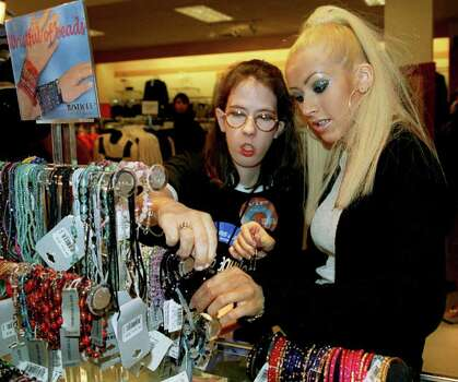 Pop superstar Christina Aguilera accompanied Shawna Winton, 18, of Dickson, Texas, on a 30-minute Sears midnight shopping spree in Burbank, Calif., early Friday Oct. 13, 2000, after Aguilera performed at the Universal Amphitheater  Winton, who has muscular dystrophy, was the grand prize winner of the Sears and Levi National Sweepstakes. Photo: DANNY FELD, AP / SEARS LEVI