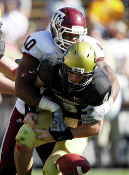 Colorado quarterback Tyler Hansen (9) is sacked by Texas A&M linebacker Von Miller (40) during the first quarter of an NCAA college football game in Boulder, Colo, Saturday, Nov. 7, 2009. Photo: JACK DEMPSEY, AP / FR42408 AP