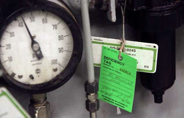 A deficiency tag hangs on a diesel generator at the South Texas Project nuclear plant near Bay City, Texas. Between 4,000 and 5,000 hours of inspections are conducted at the plant by inspectors there each year according to Nuclear Regulatory Commission officials. JOHN DAVENPORT/JDAVENPORT@express-news.net Photo: JOHN DAVENPORT, SAN ANTONIO EXPRESS-NEWS / jdavenport@express-news.net