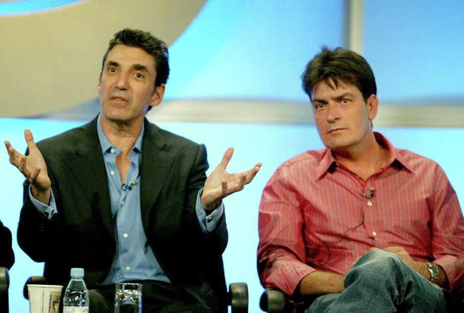 "LOS ANGELES - FILE:  Executive Producer Chuck Lorre (L) and actor Charlie Sheen attend the panel discussion for ""Two And A Half Men"" during the CBS 2005 Television Critics Association Summer Press Tour at the Beverly Hilton Hotel on July 20, 2005 in Beverly Hills, California.   CBS television network announced on February 24, 2011 that it has canceled production of its sitcom, ""Two and A Half Men"", starring Charlie Sheen, Jon Cryer and Angus T. Jones, for the remainder of the season. The network and the show's creator have cited Sheen's public statements, conduct and condition for their decision. (Photo by Frederick M. Brown/Getty Images) Photo: Frederick M. Brown, Stringer / Getty Images North America"