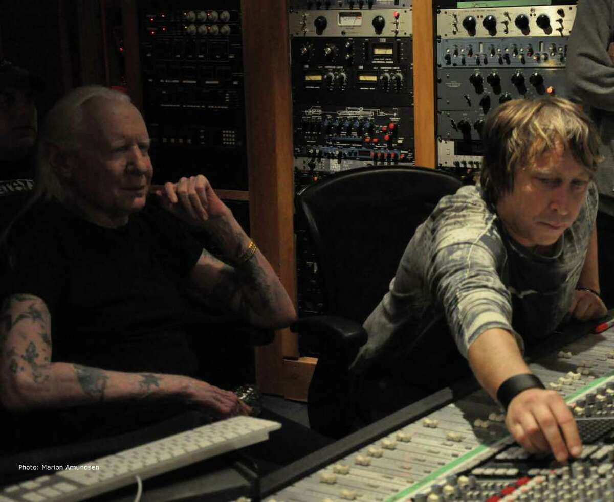 Blues legend Johnny Winter works with his manager, Paul Nelson, during a February recording session at Carriage House Studios in Stamford. Marion Amundsen/Contributed Photo.