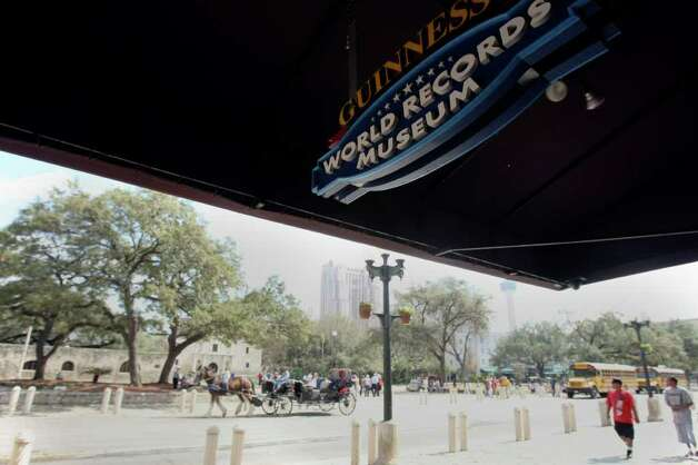 METRO:  Some people feel Alamo Plaza needs to  honor the memory of the Alamo defenders in a more appropriate way than by selling T-shirts and characters scaring pedestrians outside of Ripley's Haunted Adventures.  One project may be relocation of buildings on the west side of the plaza to allow for re-creation of the Alamo's west wall, and conversion of the 1930s federal building on the plaza's north end to a multimedia center and museum.  HELEN L. MONTOYA/hmontoya@express-news.net Photo: HELEN L. MONTOYA, SAN ANTONIO EXPRESS-NEWS / hmontoya@express-news.net