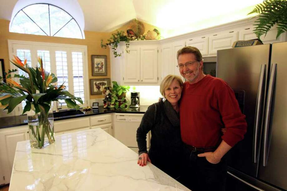 Sue Croom, an interior designer, and David Lodge updated their kitchen when they decided to replace an unreliable stove. Photo: HELEN L. MONTOYA, SAN ANTONIO EXPRESS-NEWS / hmontoya@express-news.net