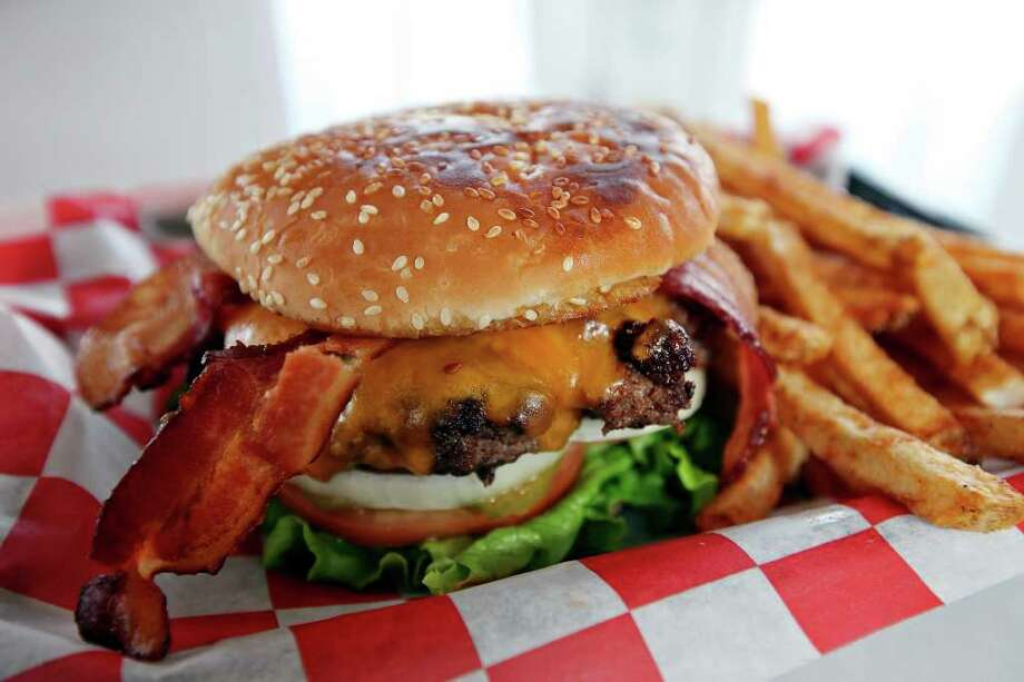Fattboy bacon and cheese burger combo is a perfectly cooked burger with nicely seasoned fries. Photo: EDWARD A. ORNELAS, SAN ANTONIO EXPRESS-NEWS / eaornelas@express-news.net