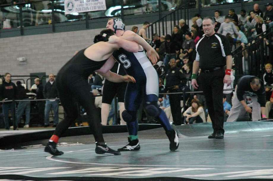 Staples senior quad-captain Chris Giunta, right, competes Ted Kostopoulos of Jonathan Law in the 215-pound weight class at State Open this past weekend. Photo: Contributed Photo / Rick Giunta