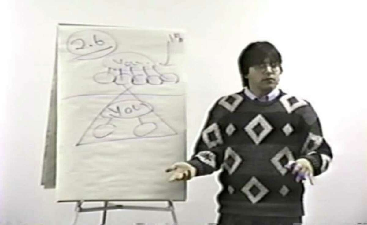 Keith Raniere in 1991 at a Consumers' Buyline training session. Raniere and his colleagues signed a consent order from the New York Attorney General agreeing to never again operate a pyramid scheme business. They were not found guilty of any wrongdoing.(TheFallofNXIVM.com)